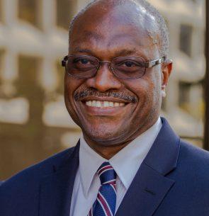 Dr. Algernon Austin